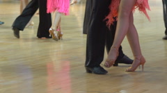 Close-up of legs of dancing couples in ballroom. Slow motion. Arkistovideo