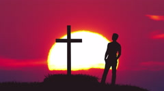 The man stand near the cross against the background of sunrise. Real time  - stock footage