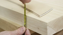 4K Close up on hands, timber being measured in carpenter's workshop - stock footage