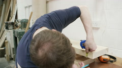 4K Professional carpenter in his workshop, measuring timber ready to be cut Stock Footage