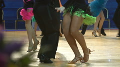 Close-up of legs of dancing couples in ballroom. Slow motion. Stock Footage