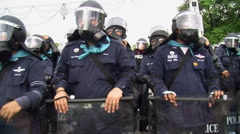 Riot Police in Full Combat Gear Confront Demonstration Shields Body Armor 9679 - stock footage