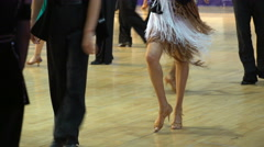 Close-up of legs of dancing couples in ballroom. Stock Footage