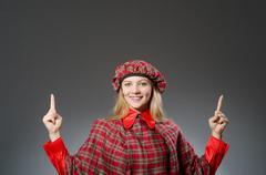 Woman wearing traditional scottish clothing - stock photo