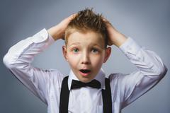 Closeup portrait headshot nervous anxious stressed afraid boy isolated grey - stock photo