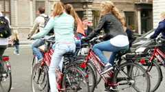 Tourists groupe on bicycles ride city tour in Rome Italy Stock Footage