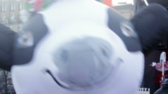 Man in Cow Costume Shaking Hands Close Up in Camera at Funfair - stock footage