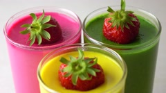 Multicolored pannacotta desserts with strawberries 4K dolly shot Stock Footage