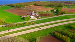 New highway divides the fertile rural landscape of farms and fields Stock Footage