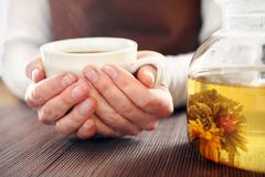 Blooming tea brewed in a glass jug. Stock Photos