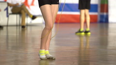Close up of female feet jumping using a Skipping Rope. Stock Footage