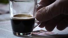 Man takes small cup of coffee Stock Footage