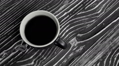 A cup with black tea on the table Stock Footage