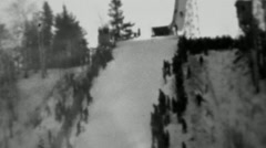 1937: Winter snowski jumping competition crowd lines steep hill. Stock Footage
