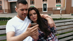 Young urban people man wearing white T-shirt and woman in checkered shirt with Stock Footage
