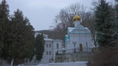 St. Nicholas Church Svyatogorsk New Year Woman Walking by Courtyard of Holy Stock Footage