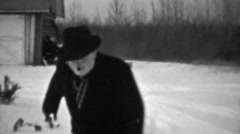 1937: Jolly old man slipping on ice winter cold weather almost falls. - stock footage