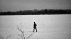 1937: Lone man venturing into winter cold snow skis without poles. Stock Footage