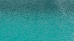 Beautiful pool water surface under the rain. Slow motion Stock Footage