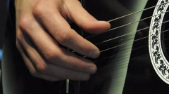 Playing Six-String Acoustic Guitar Big Hands on the Strings and Frets Stock Footage
