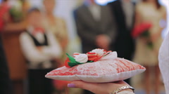 Wedding Witness is Holding Red Cushion With Rings - stock footage