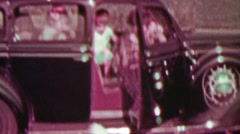 1937: Family exiting rear-hinged suicide door car visiting oceanside. Stock Footage