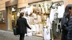 Shopping people - interior storefront of a fashionable clothes shop in Rome Stock Footage