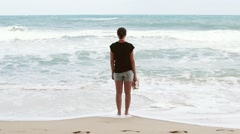 Girl looks at ocean horizont slow motion Stock Footage