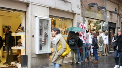 Shopping people - showcase storefront of a fashionable footwear shop in Rome Stock Footage