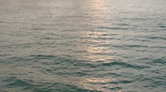 Isolated meditative calm surface of the sea at sunset. Slow motion Stock Footage