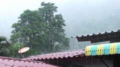 The roof of the house under a strong rain shower in the mountains. Slow motion Stock Footage