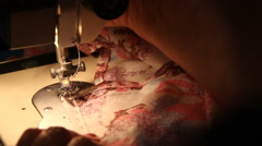 Woman work on the sewing machine Stock Footage