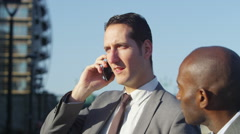 4K Smart London Businessmen outdoors in the city good news from phone call - stock footage