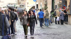 Teen age girls walking Rome street eating ice cream - gelato Italiano Stock Footage