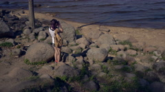 Woman taking photos to the sea with camera Stock Footage