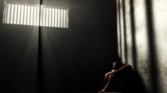 4K Prisoner in Bad Condition in Demolished Solitary Confinement under Lightr Stock Footage