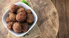 Fresh made Meatballs (seamless loopable; 4K) Stock Footage