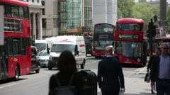 Red busses and crowds on Piccadilly Circus (very sunny day) Stock Footage
