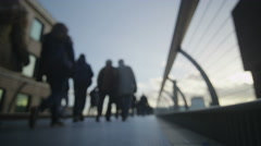 4K Anonymous city workers and tourists walking across one of London's bridges Stock Footage