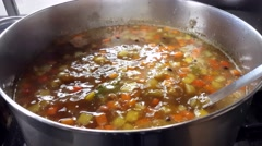 Bubbling meat soup, inside a metal pot, at a restaurant kitchen Stock Footage