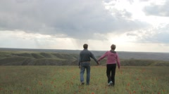 married couple having joined hands admire the nature - stock footage