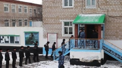 A group of prisoners enters the building Russia Stock Footage