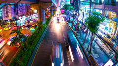 Timelapse view on traffic and and public transport in Bangkok at night - stock footage