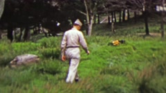 1951: Military soldier hiking in rural green grassy park. Stock Footage