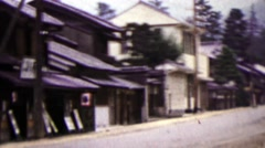 1951: Japanese quiet street woman riding bike in distance. Stock Footage