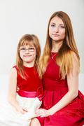 Mother and daughter posing together - stock photo