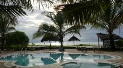 Swimming pool with palm trees in a resort in Zanzibar Tanzania Stock Footage