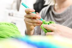 Crocheting. Hand needlework. - stock photo