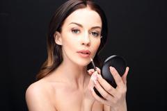 Woman performs makeup, paints lips liner pencil Stock Photos