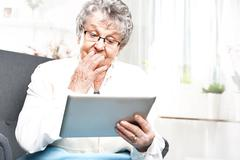 Older woman with a tablet Stock Photos